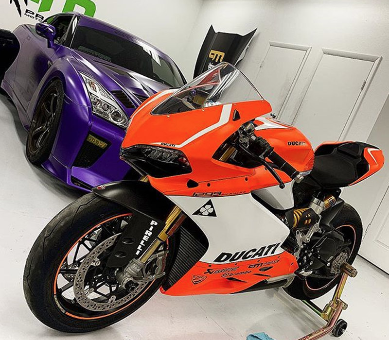 Motorcycle and Purple Car